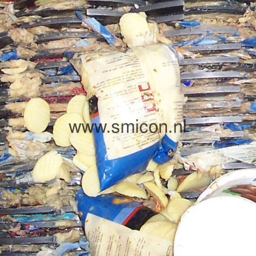 Packed foodstuffs during processing shredder